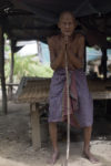 Nou Tab in his 'house' in Cambodia, elderly man with no income or health care